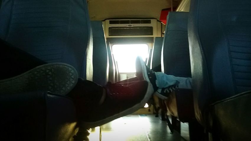 Vehicle Interior Transportation Business Finance And Industry Vehicle Seat Indoors  Adults Only Day Close-up One Person People Shoes Bus Roadtrip Legs