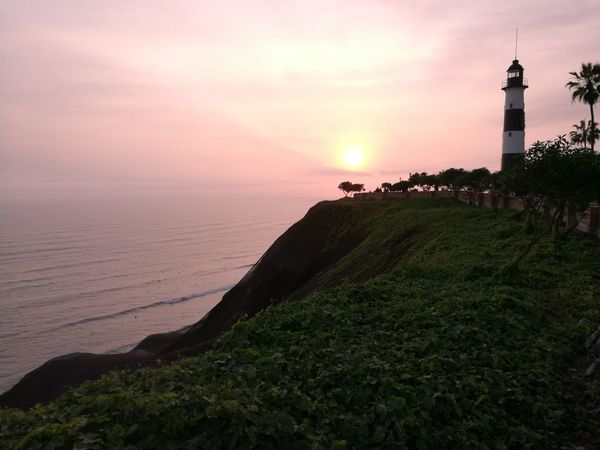 malecón Sunset Sea Horizon Over Water Lighthouse Tranquility Beach Beauty In Nature