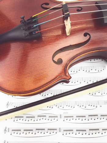 classical music instruments Practice Makes Perfect String Instrument Practicing Violin Still Life Indoors  High Angle View No People Art And Craft Close-up Paper Work Tool Occupation Equipment Wood - Material