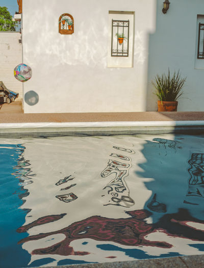 Reflection of wall in swimming pool