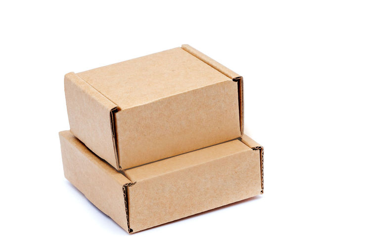 Close-up of paper box on white background