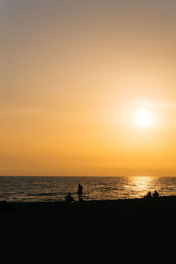 Sunset silhouettes Beauty In Nature Horizon Over Water Idyllic Leisure Activity Lifestyles Nature Nikonphotography Orange Color Outdoors Remote Scenics Sea Shore Sky Sun Sunset Tourism Tranquil Scene Tranquility Unrecognizable Person Vacations Vscofilm Water 43 Golden Moments