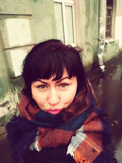 Portrait of woman puckering on street