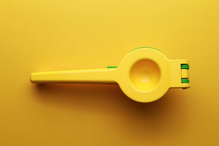 High angle view of toy car on yellow background
