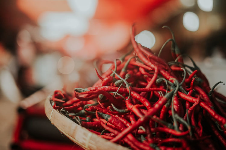 Close-up of red chili peppers in basket