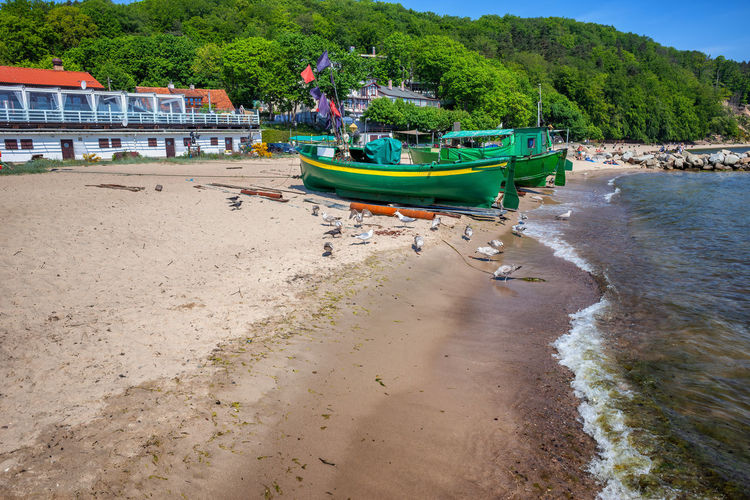 Boats moored on beach