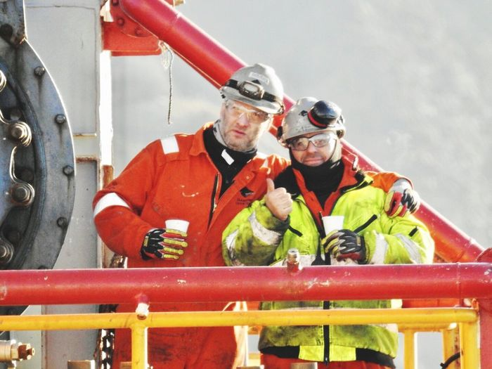 Oil&gas Mid Adult Mid Adult Men Safety Day Only Men Industry Adults Only Reflective Clothing Teamwork Protective Workwear Outdoors
