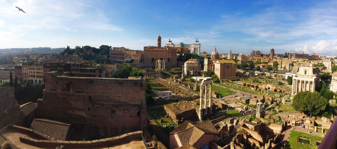 High angle view of roman forum against blue sky