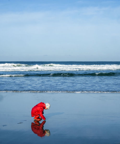 Alone Beach Beauty In Nature Blue Sky Child Childhood Contemplation Day Girl Horizon Over Water Kids Nature One Person Outdoors People Red Coat Scenics Sea Sky Sol Solitary Surf Thought Winter Winter Beach First Eyeem Photo