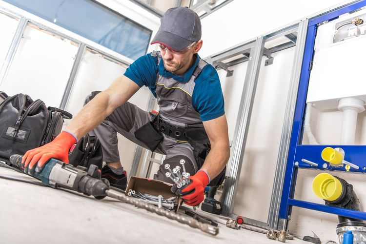 Low angle view of mid adult man working in workshop