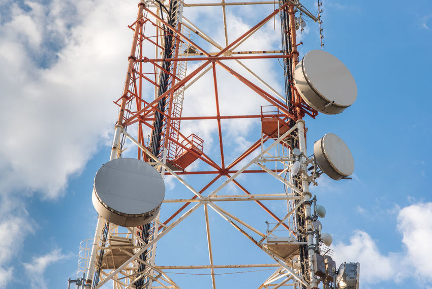 Telecommunication tower against blue sky Antenna Antenna - Aerial Architecture Broadcasting Broadcasting Tower Built Structure Cloud - Sky Day Global Communications High Low Angle View No People Outdoors Red Satellite Dish Sky Technology Telecommunications Equipment TelecommunicationTower Tower