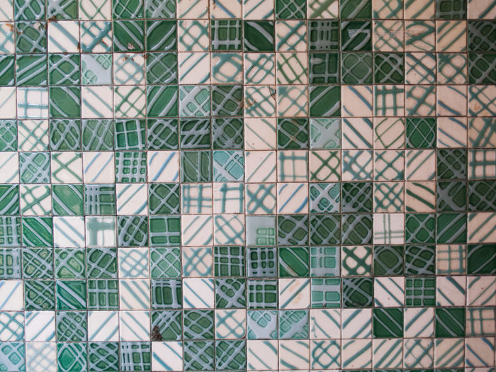 Full frame shot of green and white patterned tile wall