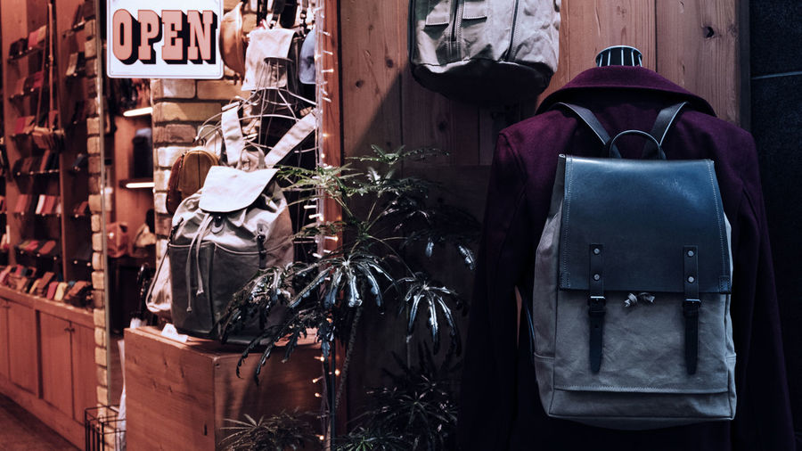 Coat with backpack hanging on wall