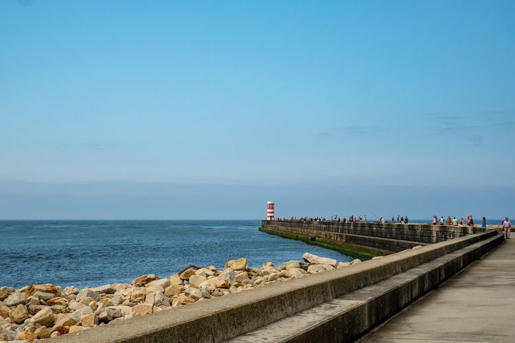 Water Sea Sky Horizon Over Water Horizon Scenics - Nature Beauty In Nature Nature Day Tranquil Scene Copy Space Blue Tranquility No People Architecture Beach Pier Built Structure Outdoors Groyne Promenade Lighthouse Promanade Causeway
