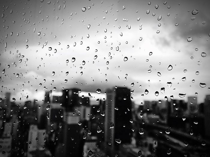Raindrops On Your Hood Drop Window Wet Rain Weather Transparent Focus On Foreground Sky Rainy Season RainDrop No People Water Day Close-up Droplet Indoors  Nature