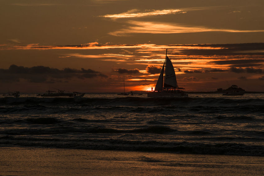 atardecer en playa tamarindo costa rica Beauty In Nature Cloud - Sky Day Lighthouse Nature Nautical Vessel No People Orange Color Outdoors Sailing Ship Silhouette Sky Sunset Transportation Travel Destinations Water