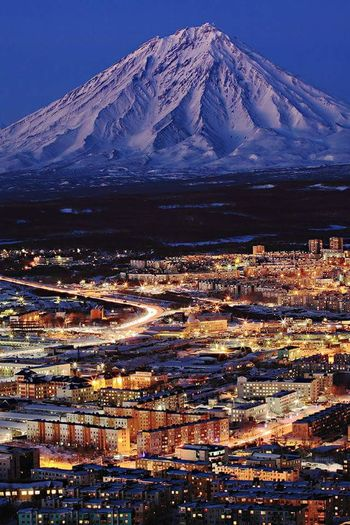Mountain Cityscape Outdoors Business Finance And Industry Built Structure Architecture No People Snow Dramatic Sky City Scenics Mountain Peak Night Illuminated Cold Temperature Sky