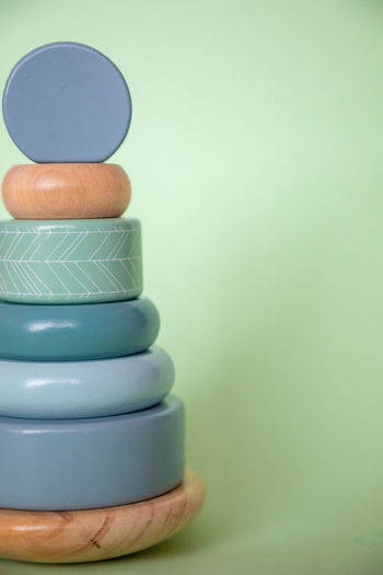 Close-up of stack of colored pencils on table against wall