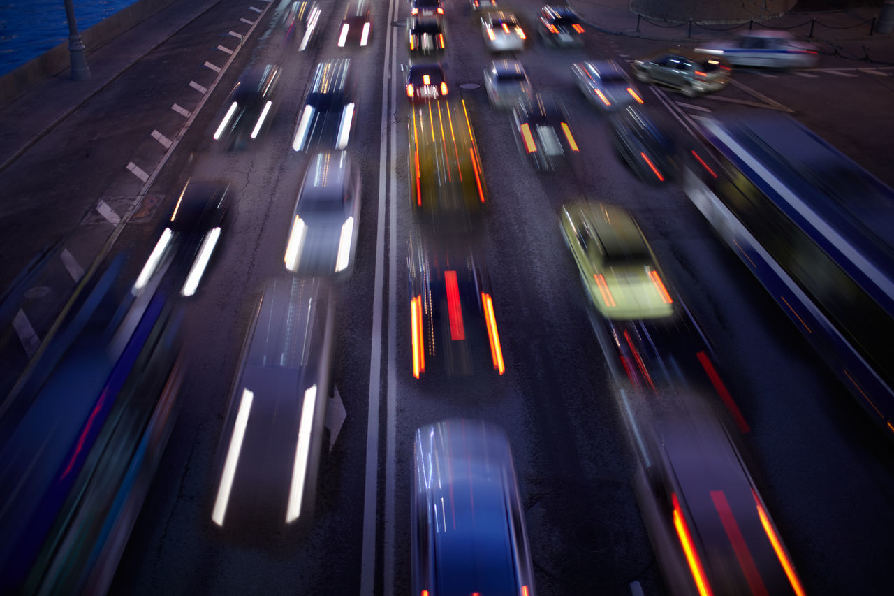 Blurred motion of cars on street at night