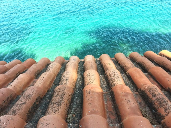 High angle view of clay tiles next to sea