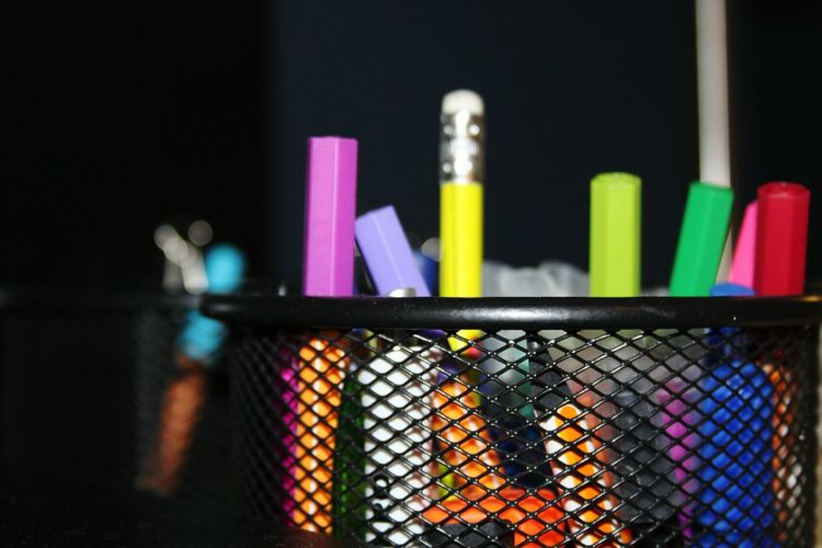 Close-up of colorful pencils in desk organizer