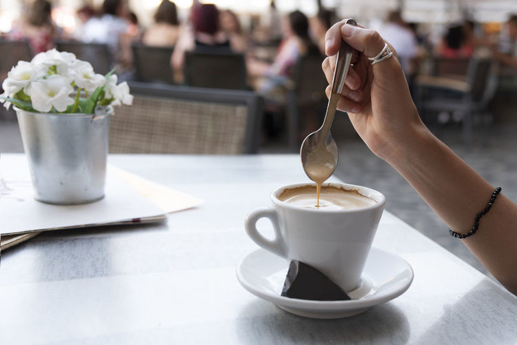 Young woman stirring a coffee. Relaxed concept Copy Space Spoon Sugar Woman Background Bar Coffee - Drink Coffee Cup Concept Crockery Cup Drink Girl Holding Hot Drink Human Hand Indoors  Mug One Person People Relaxed Spoon Stiring Wallpaper Young Adult