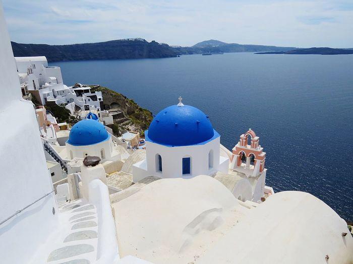 Blue Domed Churches Against Sea