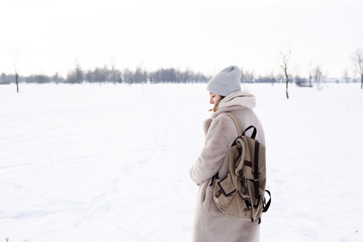 Side view of senior woman on snow covered land