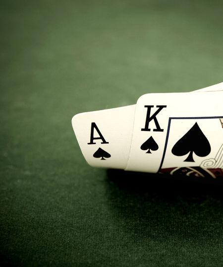 macro of ace king blackjack on green felt 21 Ace Blackjack Macro Photography Cards Gambling Green Felt Leisure Games Luck No People Spades Still Life