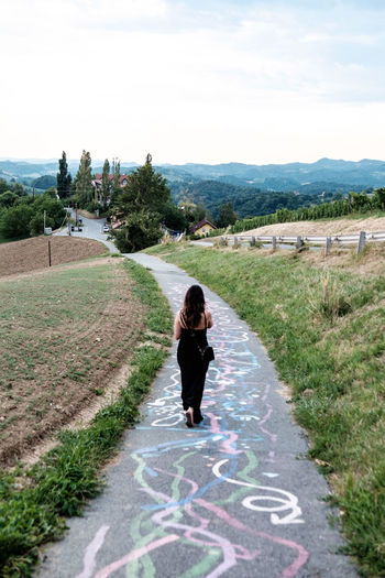 Austria / South Styrian Wine Road (Südsteirische Weinstrasse) Austria Beautiful Hills Paint Path Road Strolling Trees Vineyards  Woman Adult Beauty In Nature Concrete Day Drawings Grass Nature One Person Outdoors Sky Styria Summer Tree Walking Winding Road