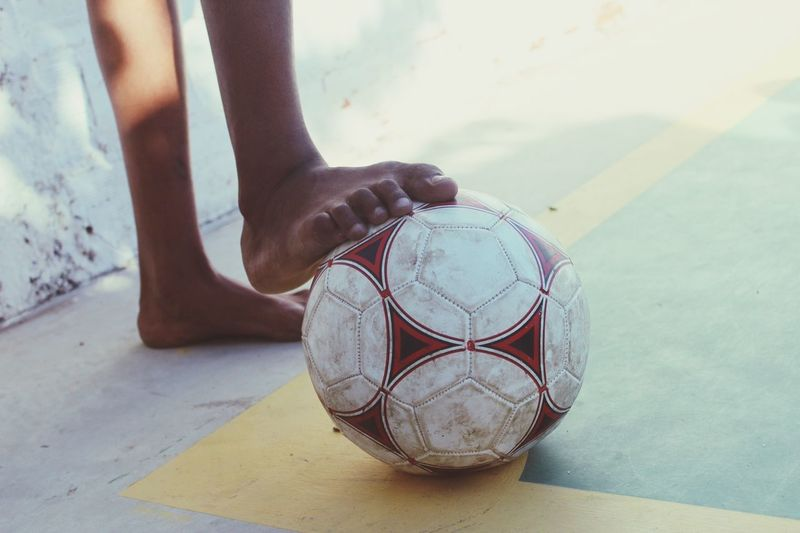 Low section of boy with soccer ball