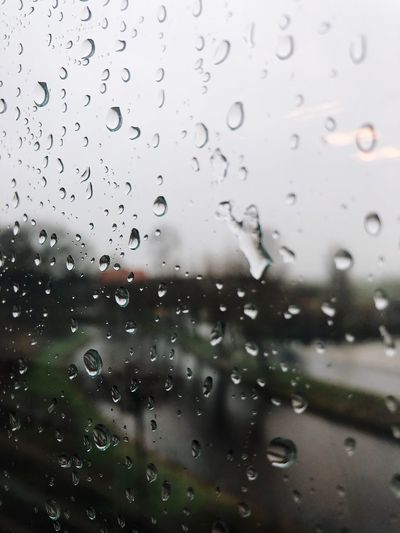 Drop Window Wet No People Water RainDrop Close-up Sky Nature Focus On Foreground Full Frame Backgrounds Day Indoors