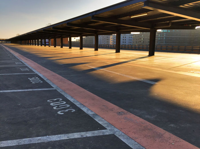 Empty parking lot at sunset