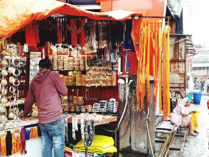Rear view of man standing at market stall
