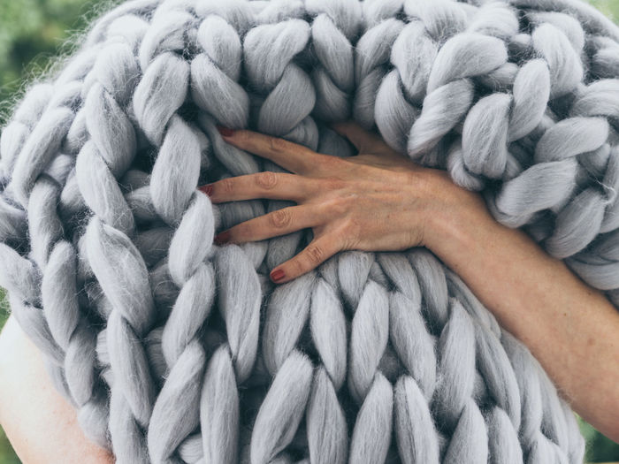Adult Body Part Close-up Complexity Connection Day Finger Gray Hand Holding Human Body Part Human Hand Human Limb Intertwined Lifestyles One Person Pattern Real People Rope Softness Strength Tangled Textile Wool