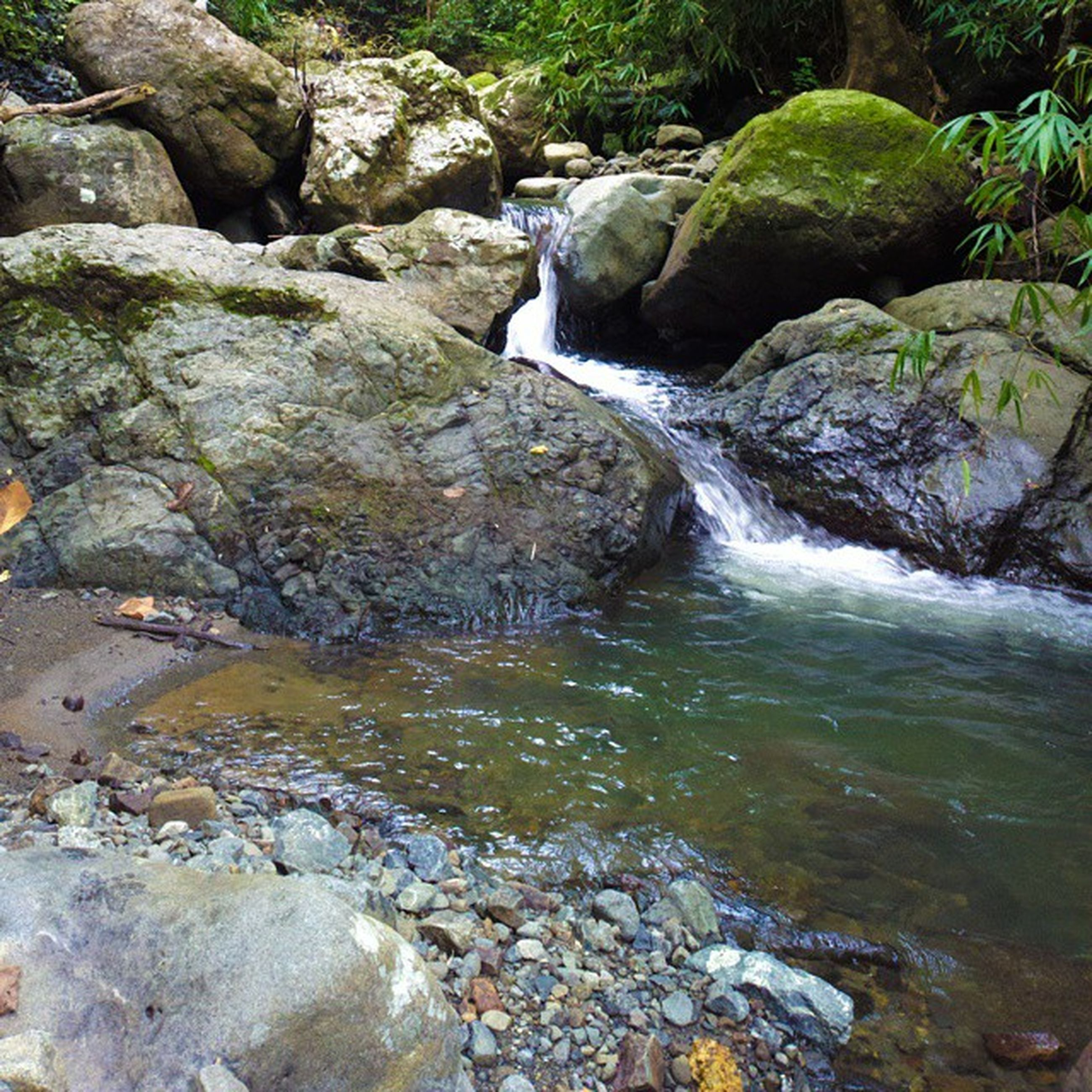 rock - object, water, rock formation, rock, nature, beauty in nature, flowing water, stream, motion, stone - object, flowing, scenics, waterfall, stone, tranquility, river, moss, tranquil scene, day, outdoors
