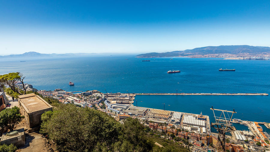 High angle view of bay against clear blue sky