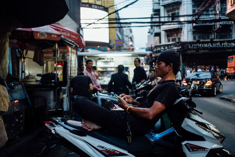 Chinatown Bangkok Adult Architecture Building Exterior Built Structure Car City Day Land Vehicle Large Group Of People Men Mode Of Transport Motorcycle Outdoors People Real People Sitting Technology Transportation Women Young Adult