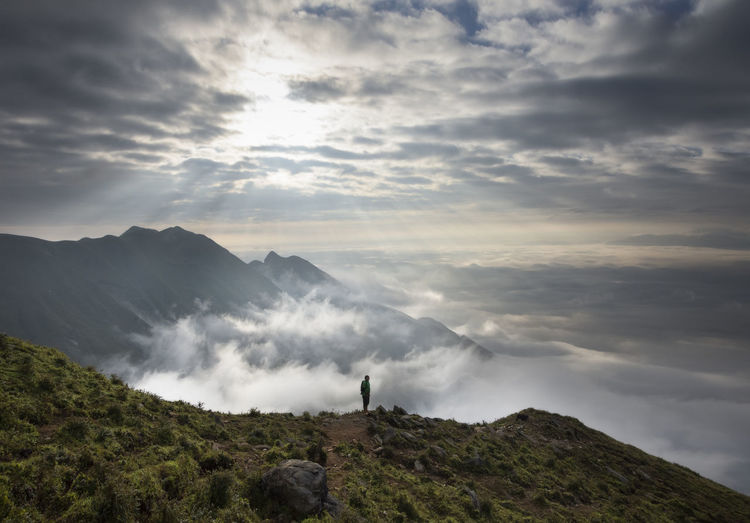 High angle view of man standing against cloudscape