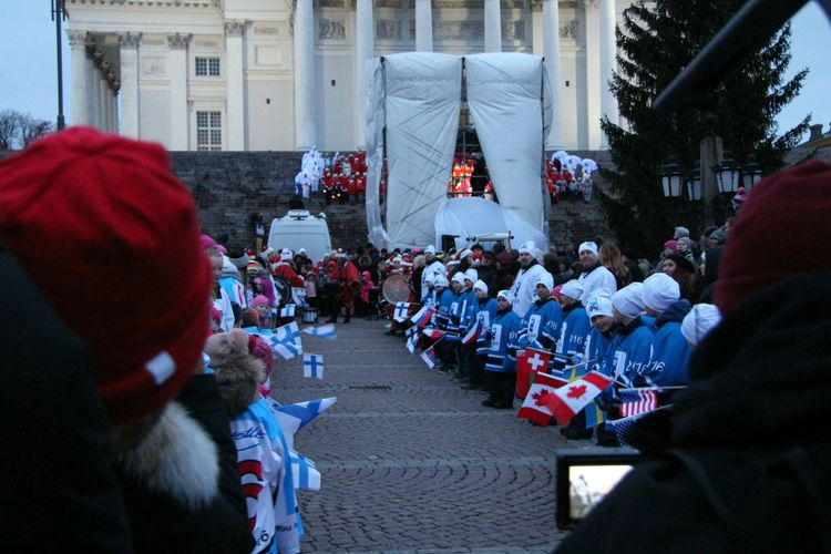 Christmas Around The World at At Senaatintori / Senate Square Helsinki waiting for Santa Claus for Christmas Parade left sideFside Children from Finland right side children from other countries. Christmas Spirit