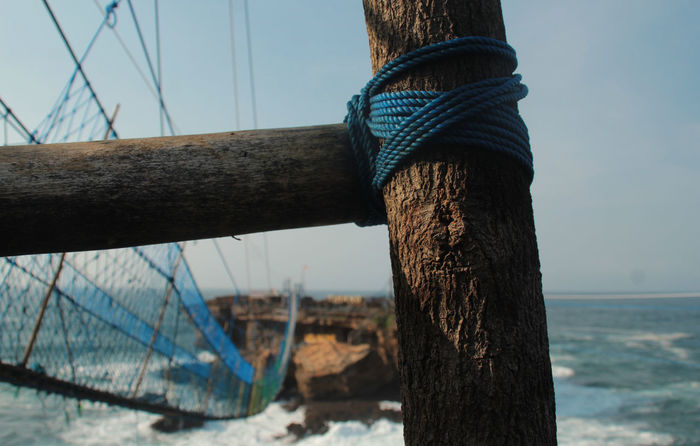 Wood & Rope on Sea side Rope Rope Bridge Seaside Exploring Wood WoodLand Close-up Day Nature Nautical Vessel No People Outdoors Rijall Rijall Blues Rijallblues Rope Art Rope Seaside Ropes Sea Seaside Sky Tree Trunk Water Wood - Material Wooden Wooden Texture
