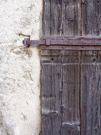 Old weathered wooden door detail Architecture Building Exterior Built Structure Close-up Day Door Hinge Latch No People Outdoors Protection Textured  Weathered Wood - Material