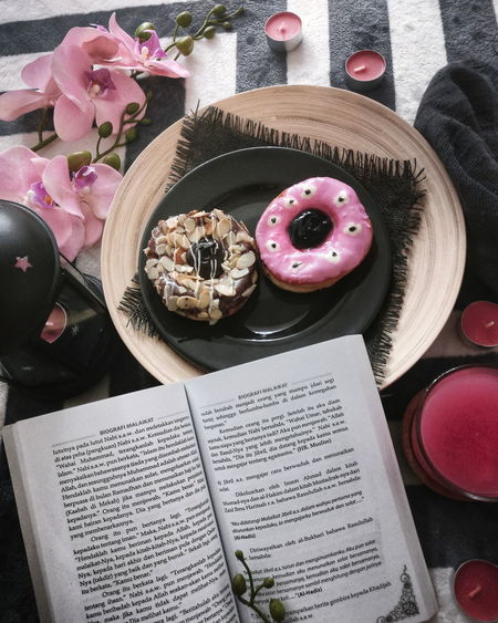 Donut and book Relaxing Comfortable Read And Relax Eat And Read Delicious Plate Dessert Table High Angle View Sweet Food Food And Drink