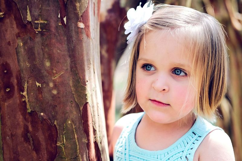The Portraitist - 2017 EyeEm Awards Exceptional Photographs Love Tree Frame Portrait Cute Girls Close-up Outdoors Blond Hair Headshot Child Smiling Hand Relaxing Girl Fujifilm Live For The Story Live For The Story Exceptional Photography Portrait Photography Summertime BYOPaper!