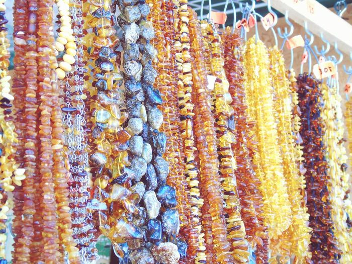 Marketplace Necklace Stones Orange Yellow Brown Up Close Street Photography