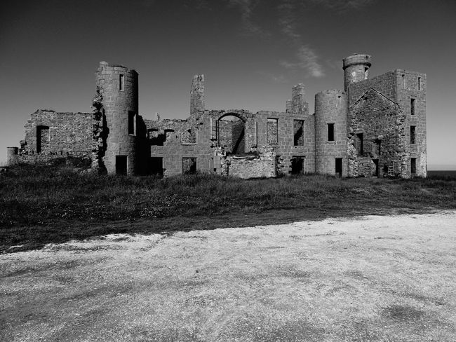 Slains Castle Black & White Cruden Bay EyeEm Gallery EyeEmNewHere Ghosts Scotland Slains Castle Spooky Atmosphere Abandoned Ancient Civilization Architecture Built Structure Castle Forgotten Places  History No People Old Ruin Ruins Architecture The Past Your Ticket To Europe The Week On EyeEm Lost In The Landscape Discover Berlin Black And White Friday