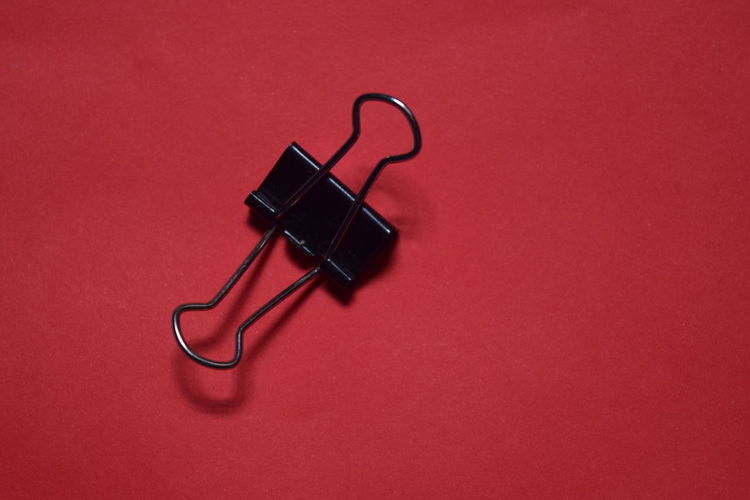 Technology Equipment Paper Clip Coathanger Black Color Connection Office Supply Metal Table Colored Background Single Object High Angle View Clip Red Close-up Studio Shot Copy Space No People Still Life Indoors  Cable Indoors