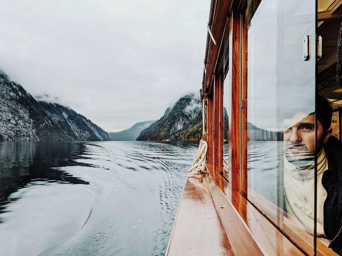 Man looking through boat window