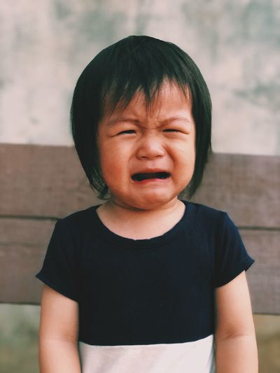 Close-up of cute girl crying outdoors