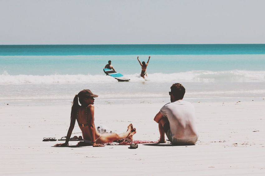 2^2. Beach Sea Water Sand Horizon Over Water Shore Nature Beauty In Nature Sky Outdoors Day Scenics Sitting People Couple Couples